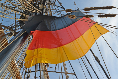 National flag of Germany flutters among tackles of the sailing vessel Editorial
