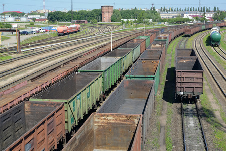 empties: KALININGRAD, RUSSIA - JUNE 23, 2016: Empty freight trains stand Kaliningrad-sorting on the ways of railway station