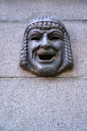 st  petersburg: Maskaron - a theatrical mask on a granite wall. St. Petersburg Editorial