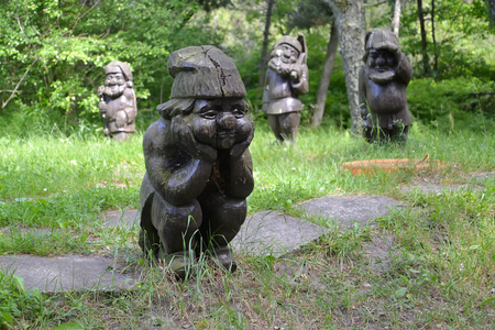 KALININGRAD REGION, RUSSIA - JUNE 13, 2016: Wooden sculptures Gnomes in the park