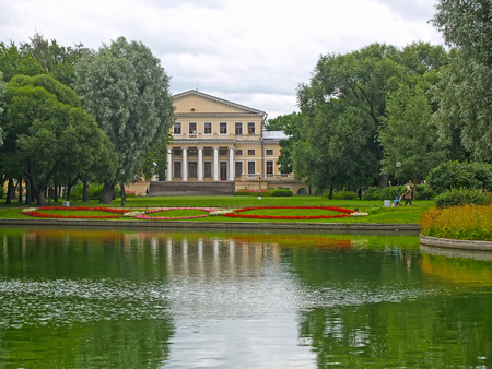 ST. PETERSBURG - JULY 14, 2014: A view of a pond and the Yusupov Palace in the Yusupov garden