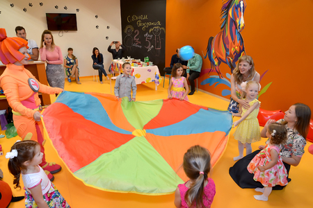 KALININGRAD, RUSSIA - SEPTEMBER 18, 2016: Children play with the animator. A holiday in childrens club Editorial
