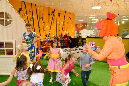 KALININGRAD, RUSSIA - SEPTEMBER 18, 2016: The animator in a suit starts up soap bubbles on a children's holiday
