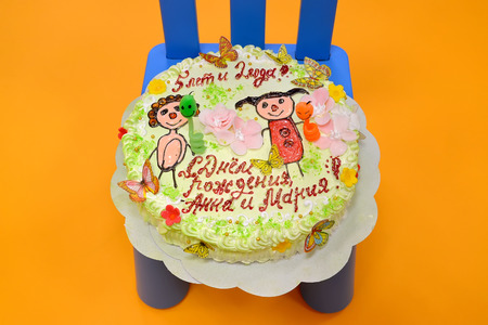 illustrated: KALININGRAD, RUSSIA - SEPTEMBER 18, 2016: Childrens cake Happy Birthday, Anna and Maria!. The illustrated editorial