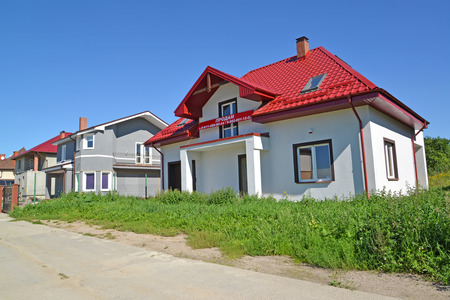 without window: KALININGRAD REGION, RUSSIA - AUGUST 25, 2016: The street in the cottage settlement. An inscription on a banner in Russian: I will sell Editorial