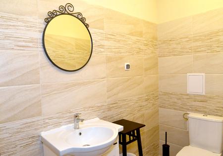 bathroom wall: Mirror on a bathroom wall. Interior