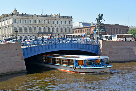 nikolay: ST. PETERSBURG, RUSSIA - JULY 11, 2016: The excursion ship passes under Blue Bridge through the Moika River