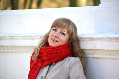 Portrait of the young woman with a red scarf Stock Photo