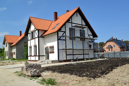 The building site in the cottage settlement. Stylization under fakhverkovy style Stock Photo