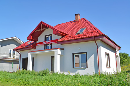 KALININGRAD REGION, RUSSIA - AUGUST 25, 2016: I will sell a new cottage with a banner. An inscription on a banner in Russian: I will sell Editorial