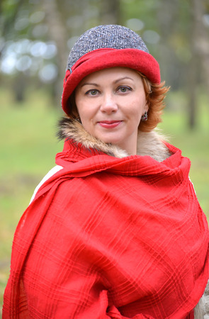 stole: The womans portrait in a red stole and a hat