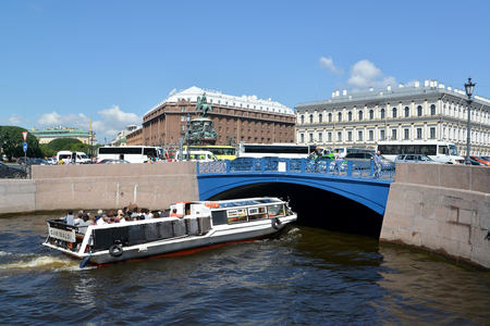 nikolay: ST. PETERSBURG, RUSSIA - JULY 11, 2016: The excursion ship floats under Blue Bridge through the Moika River in summer day Editorial