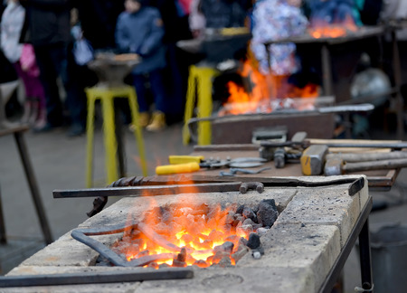 Forge braziers with tools on a holiday of forge craft Foto de archivo