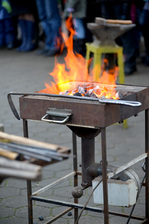 Forge brazier with a poker on a holiday of forge craft