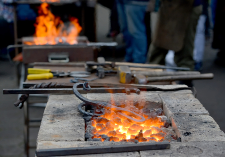 Forge braziers with tools at a festival of forge craft Foto de archivo