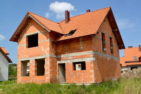 Construction of a cottage from red ceramic blocks Stock Photo