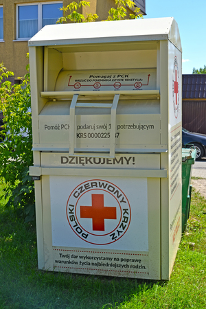 BRANIEWO, POLAND - JUNE 07, 2016: A container for collection of things by the person in need of the Polish Red Cross