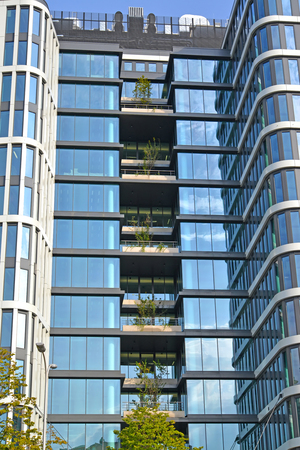 WARSAW, POLAND - AUGUST 23, 2014: Fragment of a glass facade of the modern office building Editorial