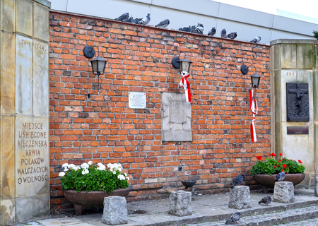 WARSAW, POLAND - AUGUST 23, 2014: A memorial to the dead during the Warsaw revolt on January 28, 1944. The Polish text The holy site watered with blood of the residents of Warsaw fighting for freedom