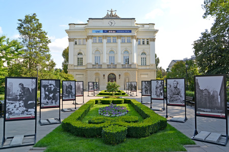 WARSAW, POLAND - AUGUST 23, 2014: A view of the main case of the Warsaw university and a photo exhibition about the Warsaw revolt of 1944