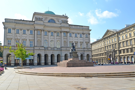 nikolay: WARSAW, POLAND - AUGUST 23, 2014: Building of the Polish academy of Sciences and monument to Nicolaus Copernicus