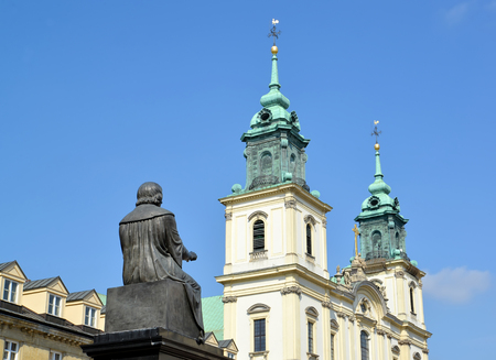 WARSAW, POLAND - AUGUST 23, 2014: A monument to Nicolaus Copernicus and a church of the Sacred Cross against the background of the sky Editorial