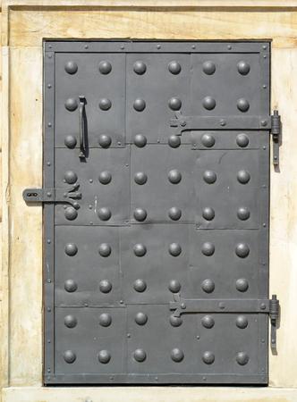 rivets: Metal decorative door with rivets Stock Photo