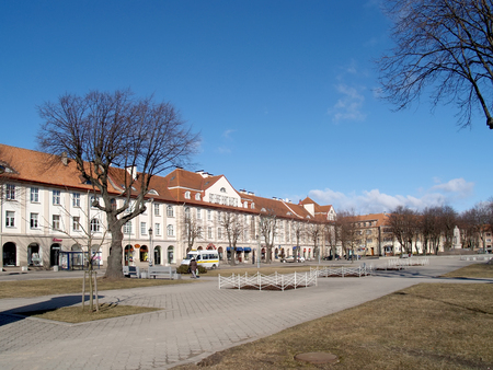 passerby: KLAIPEDA, LITHUANIA - MARCH 14, 2012: A view of the square in spring day