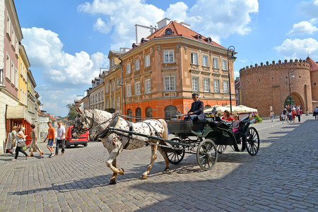 WARSAW, POLAND - AUGUST 23, 2014: The tourist horse crew goes down the street