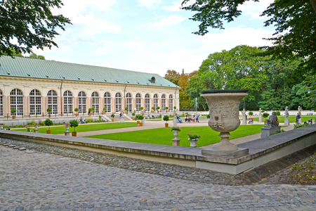 WARSAW, POLAND - AUGUST 23, 2014: A view of a garden and the building of the Old greenhouse in the Lazenki park Editorial
