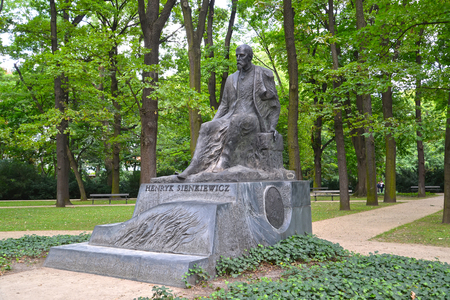 WARSAW, POLAND - AUGUST 23, 2014: A monument to the Polish writer Henryk Sienkiewicz in the Lazenki park