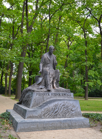WARSAW, POLAND - AUGUST 23, 2014: A monument to the famous writer Henryk Sienkiewicz in the Lazenki park