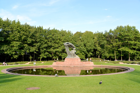 WARSAW, POLAND - AUGUST 23, 2014: A view of a monument to Frederic Chopin in the Lazenki park Editorial