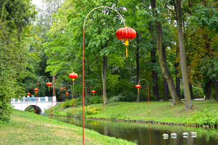 The Chinese small lamps on the bank of the channel in the Lazenki park. Warsaw, Poland Stock Photo