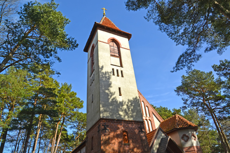 The belltower of the church of the Holy Monk Seraphim of Sarov (the church of Rauschen) against the sky.  Svetlogorsk, Kaliningrad Region Stock Photo