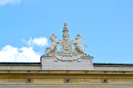 Sculptural composition of the coat of arms of noblemen Urusky on the building of the palace. Warsaw, Poland