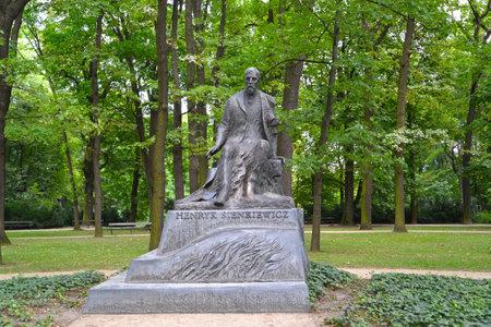 WARSAW, POLAND - AUGUST 23, 2014: A monument to the  writer Henryk Sienkiewicz in the Lazenki park Editorial