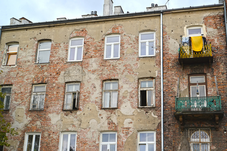 peeledoff: The peeled-off facade of the old residential building on Zamoysky Street. Warsaw, Poland