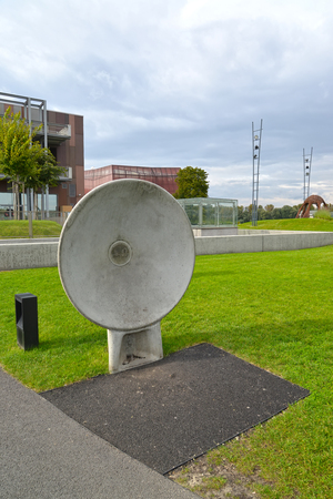 WARSAW, POLAND - AUGUST 27, 2014: An acoustic plate in the park of Openers. Center of science of Copernicus