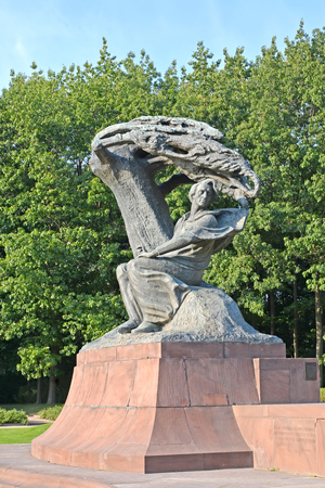WARSAW, POLAND - AUGUST 23, 2014: A monument to the composer Frederic Chopin against the background of trees
