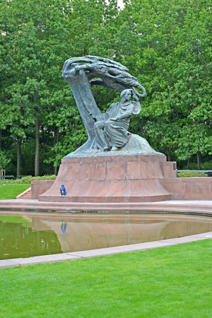 frederic chopin: WARSAW, POLAND - AUGUST 23, 2014: A monument to Frederic Chopin on the bank of a pond