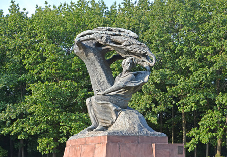 frederic chopin: WARSAW, POLAND - AUGUST 23, 2014: A monument to the composer Frederic Chopin against the background of trees
