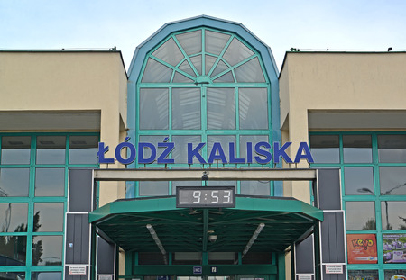 LODZ, POLAND - AUGUST 27, 2014: A sign name on the building of the railway station of the Lodz-Kalisky station. Polish text Lodz-Kalisky