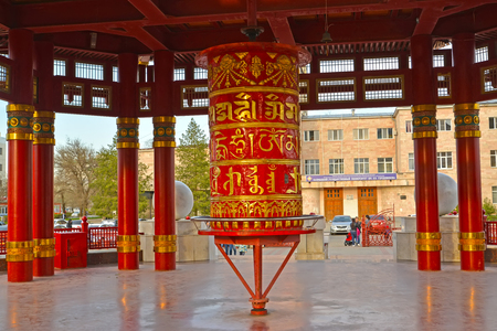 ELISTA, RUSSIA - APRIL 18, 2017: A prayer wheel with a mantra of Ohms of Manya Padme Hum in a pagoda of Seven Days Editorial