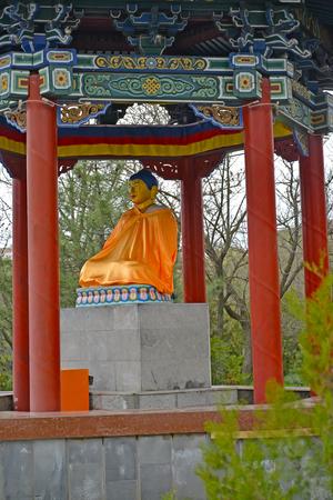 Buddha Shakyamunis statue in a rotunda arbor. Elista, Kalmykia