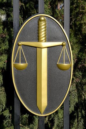 ELISTA, RUSSIA - APRIL 20, 2017: Justice symbols - a sword and scales on a protection Editöryel