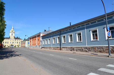 The street with one-storey houses overlooking a city town hall. Hamina, Finland