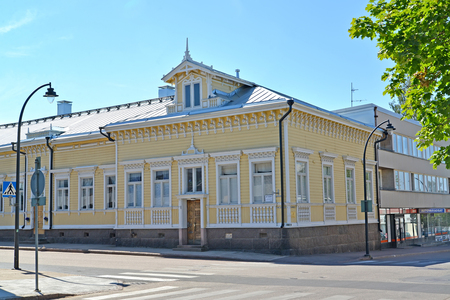 penthouse: HAMINA, FINLAND - JULY 12, 2014: A wooden house with carved decoration of a facade