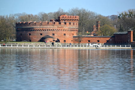 KALININGRAD, RUSSIA - APRIL 11, 2015: A tower of Der Don (the museum of Amber) on the bank of the Top lake in spring day