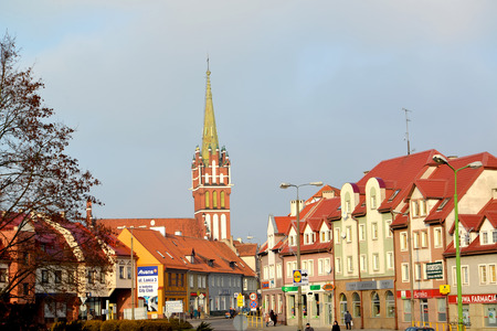 KENTShIN, POLAND - JANUARY 02, 2014: View of Vladislav Sikorsky Street and spike of a church of St. Katarzhina